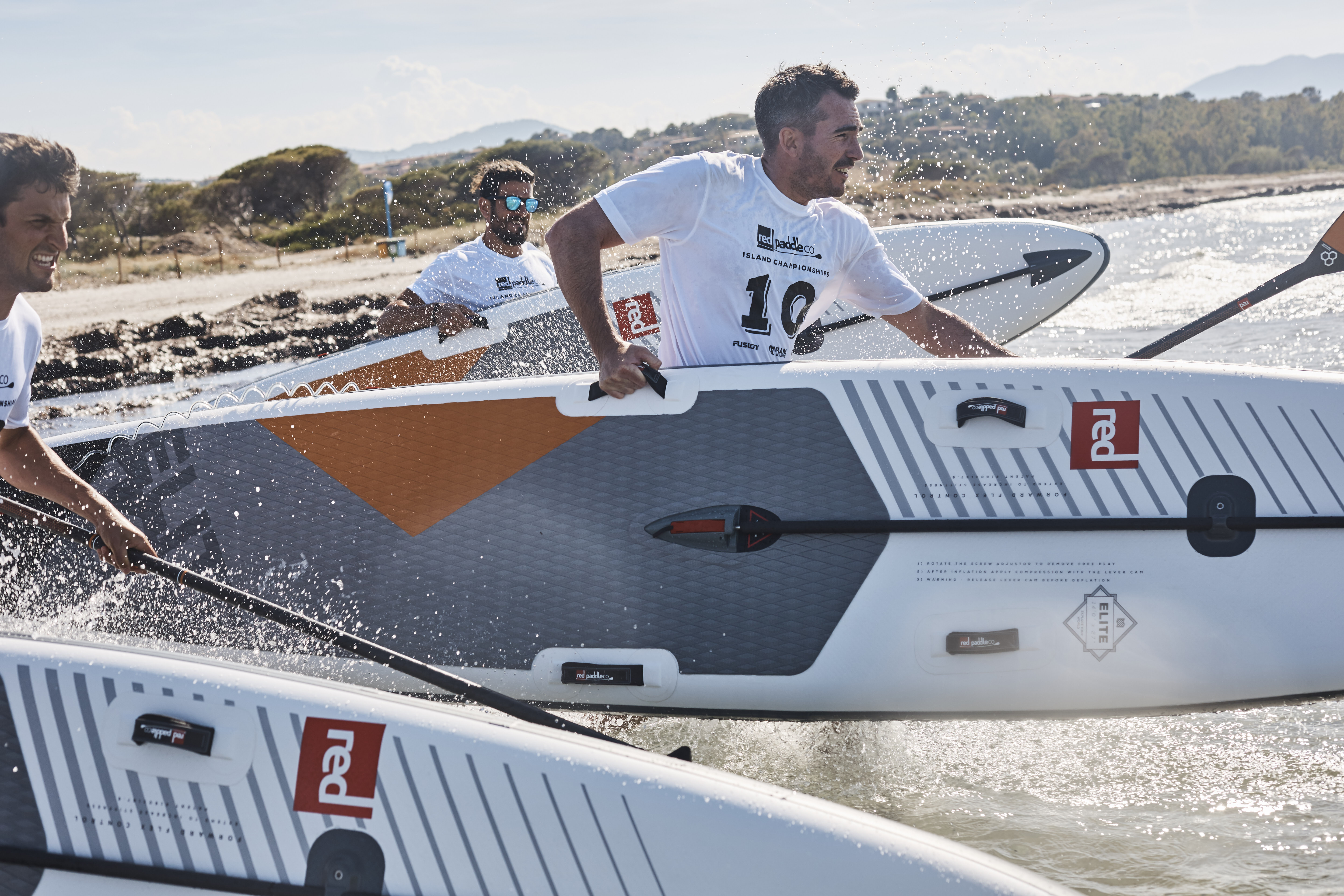 Men racing with Red Paddle Co boards