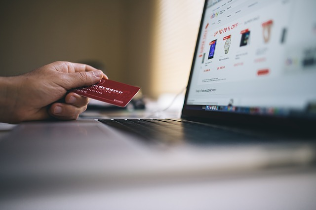 Man buying things online with credit card