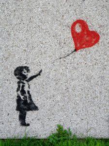 Girl letting go of balloon