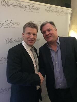 Tim Butler & Ed Balls shake hands