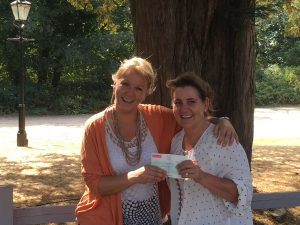Director of Innovation Visual, Joanna Butler presenting cheque to Karen Botha