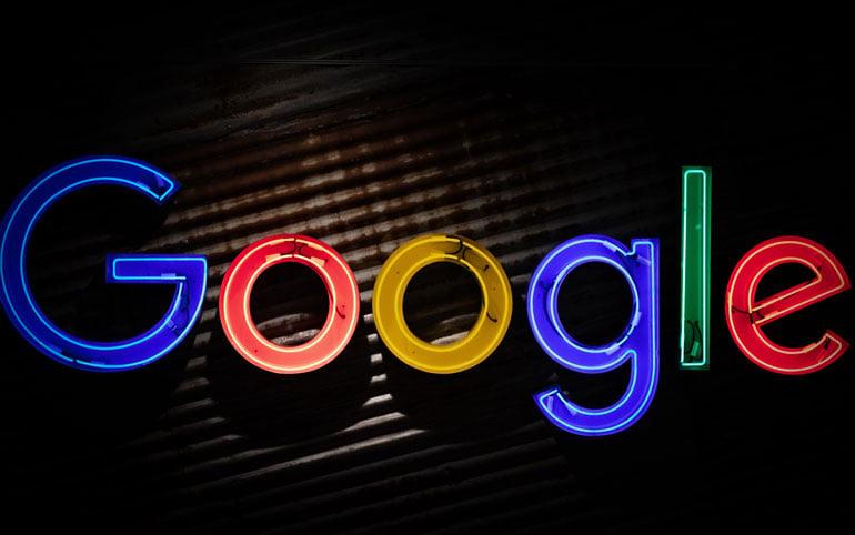 Neon Google logo on rusted metal