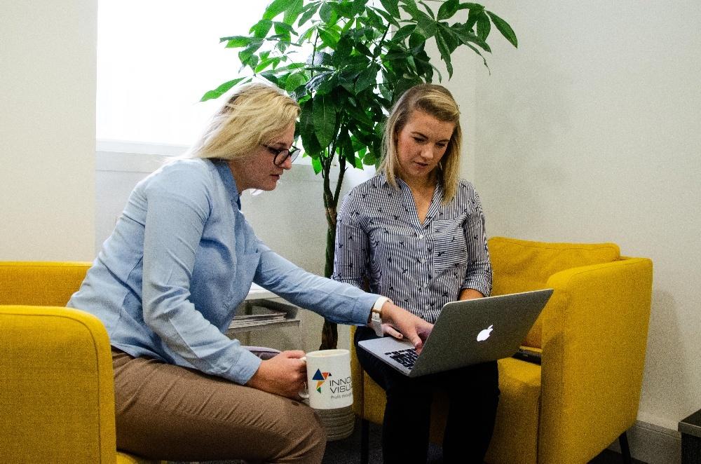 Innovation Visual team discussing digital marketing in Surrey office