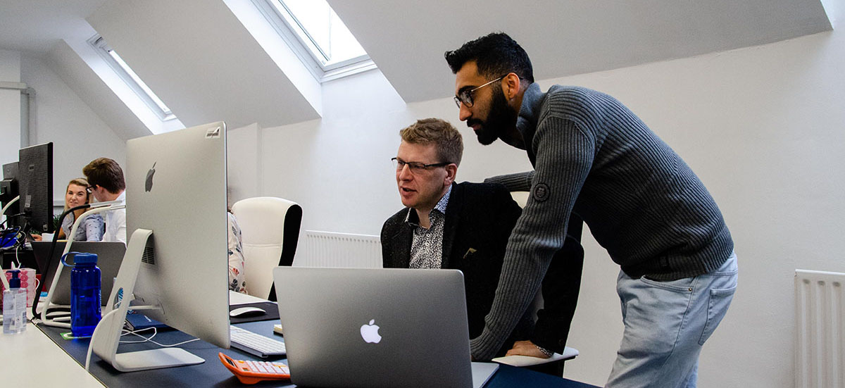 Innovation Visual team discussing website analytics