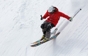 Man skiing down snow covered mountain