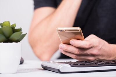 man searching on mobile device